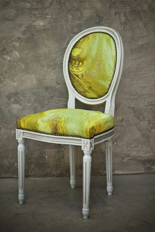 Vintage chair with a blue-green fabric