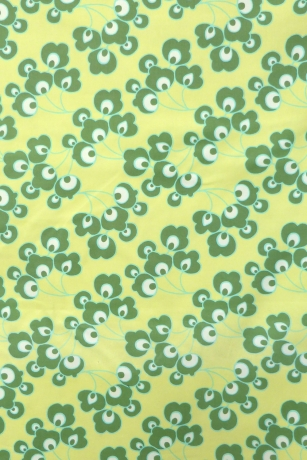 Light green fabric with green leaves