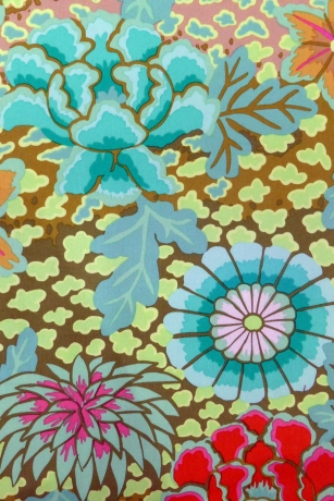 Green fabric with colorful flowers